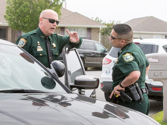 Santa Rosa County Sheriff Bob Johnson, left, talks with public information officer Rich Aloy before heading to the hospital to check on a deputy injured during an officer involved shooting on Bright Water Drive in Midway on Tuesday, March 27, 2018.