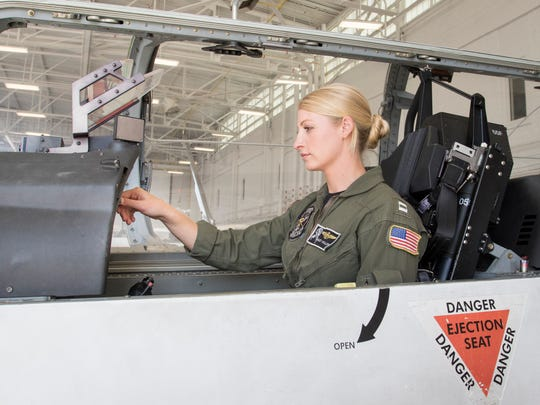 Lt. Ashley Hallford sits in the cockpit of a T-6B Texan