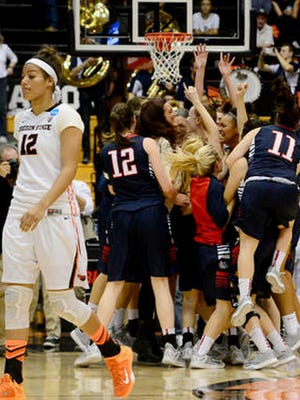Gonzaga celebrates its win over Oregon State on Sunday night, which allowed it to advance to the Sweet 16 in Spokane, Wash.