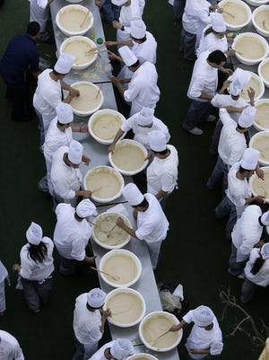 Lebanese chefs prepare the largest plate of hummus to set a new Guinness world record in Beirut in 2010.