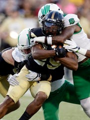 The North Texas defense did a good job of gang-tackling former Golden Eagle running back Ito Smith last year in Hattiesburg.