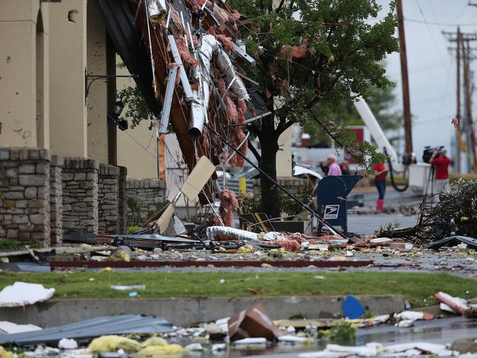 Damage left by a storm in Tulsa, Okla is shown on Sunday,