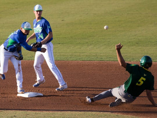 FGCU's Julio Gonzalez turns the double play as USF's Coco Montes (5) attempts to disrupt the play at Swanson Stadium Wednesday, March 22, 2017 in Fort Myers.