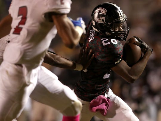 Chiles' Morris Canty runs the ball against Leon during