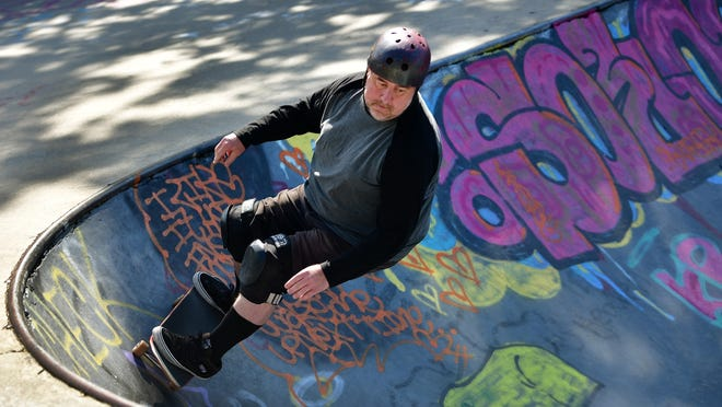 Mike McDonnell, who has been skateboarding for about 35 years, takes a morning ride at the skate park at Green Hill Park on Sunday.