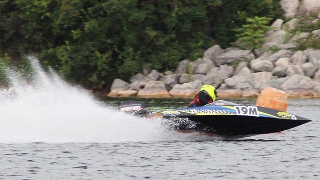 Dustin Fierek of Hessel makes a turn in the Cheboygan River on Saturday. Fierek earned the win in the 25SSR Class.