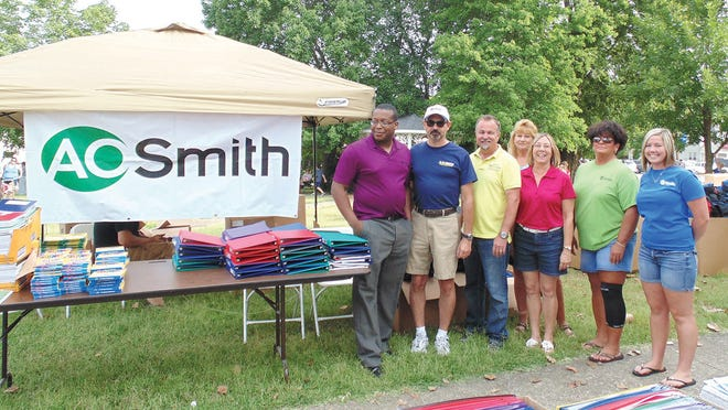A.O. Smith volunteers are pictured with the late Cheatham County mayor David McCullough at the Mayor's Back to School Bash in this file photo.