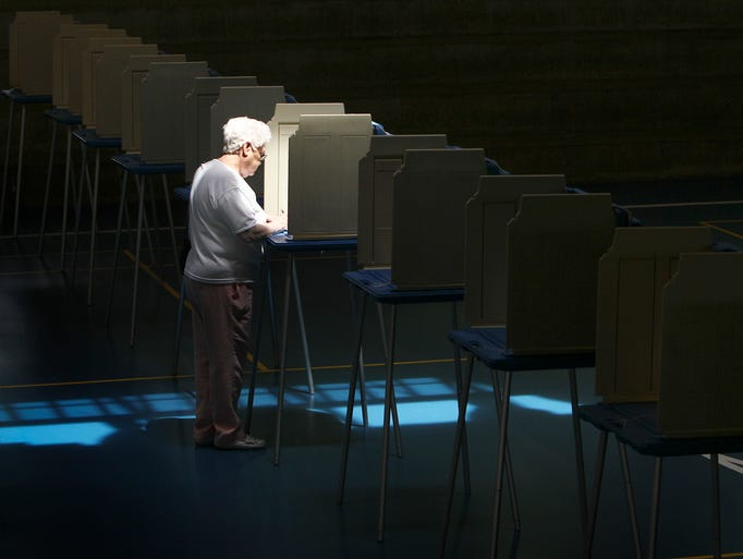 The voting booths at E.P. Tom Sawyer State Park steadily occupied most of the day but around noon Mildred Finn found herself the only one casting her vote in the primary election. May 20, 2014