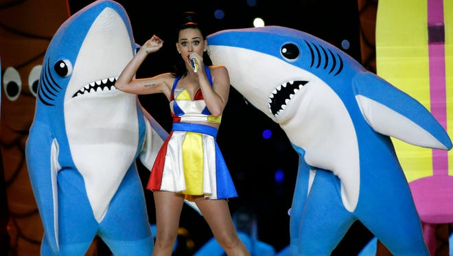 In this Feb. 1, 2015, file photo, singer Katy Perry performs during halftime of the NFL Super Bowl XLIX football game in Glendale, Ariz. The dancing sharks that stole some of the spotlight during Perry's Super Bowl halftime show have taken a bite out of an artist's bid to sell small figurines of them. (AP Photo/David J. Phillip, File)