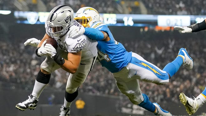 Raiders fullback Alec Ingold (45) scores a touchdown against Chargers outside linebacker Kyzir White during a Nov. 7, 2019, game at the Oakland Coliseum.