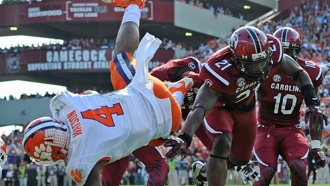 Clemson quarterback Deshaun Watson (4) dives into the end zone to score on a 5 yard carry against South Carolina Saturday at Carolina's Williams Brice Stadium.