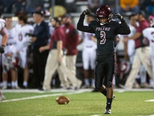 Fulton's Joey Smith celebrates after a play during