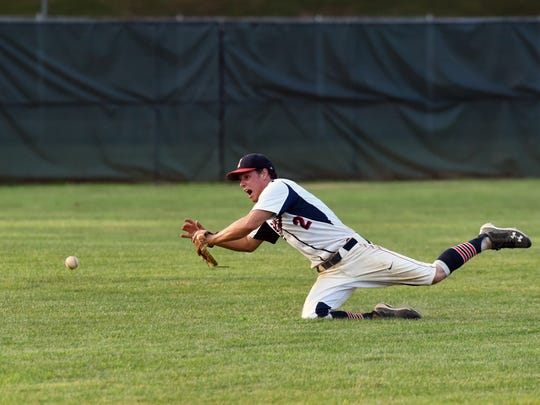 Junior Pioneers shortstop Luke Klinehoffer dives for a ball in the outfield during the Junior Pioneers' 10-9 loss in 13 innings against the Senior Pioneers at Gant Municipal Stadium. The Seniors trailed 9-1 in the ninth inning before rallying for eight runs to tie the game.