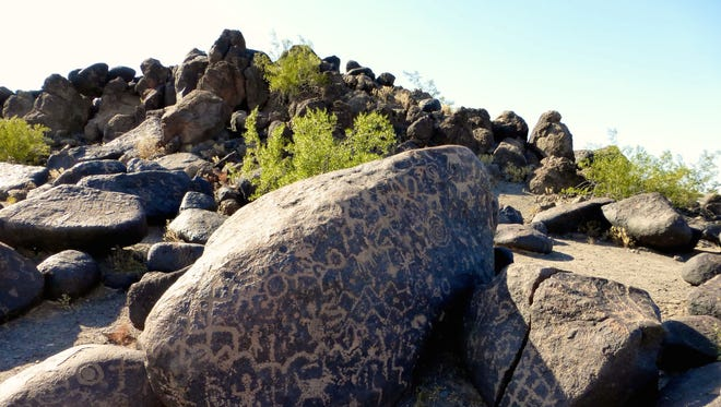 At Painted Rock, hundreds of petroglyphs are etched or pecked into the basalt boulders that crown a small hill.