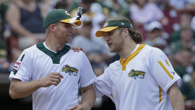 Clay Matthews, right, talks with Jordy Nelson as he rounds the bases during the Jordy Nelson Charity Softball Game on June 3, 2017 at Neuroscience Group Field at Fox Cities Stadium in Grand Chute.