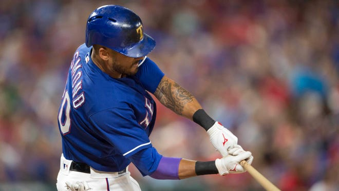 Texas Rangers center fielder Ian Desmond (20) hits a two run home run against the Houston Astros during the eighth inning at Globe Life Park in Arlington. The Rangers defeat the Astros 4-3.