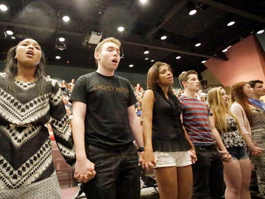 A group of SCPA students sing during Monday's CPS board