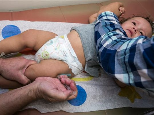 Pediatrician Charles Goodman vaccinates 1-year-old