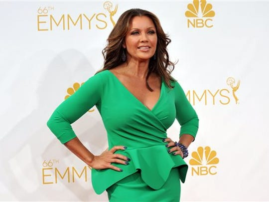 FILE - In this Aug. 25, 2014 file photo, Vanessa Williams arrives at the 66th Annual Primetime Emmy Awards in Los Angeles. The Miss America Organization, Dick Clark Productions and the ABC television network announced Tuesday, Sept. 8, 2015, that they are bringing back the actress and singer to serve as head judge for the 2016 competition. Williams, the first African-American Miss America, won the title in 1984 but resigned after Penthouse magazine published sexually explicit photographs of her taken several years earlier.