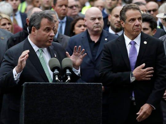 New Jersey Gov. Chris Christie, left, speaks during a news conference on the train crash at the Hoboken Terminal as New York Gov. Andrew Cuomo, right, listens, Thursday, Sept. 29, 2016, in Hoboken, N.J.