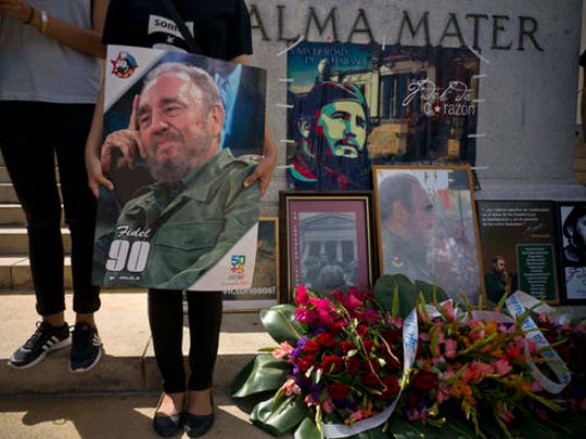 People with images of Fidel Castro gather one day after