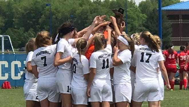 The Marshall girls soccer team celebrates its Division 2 district championship on Saturday at Harper Creek High School.