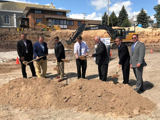 City leaders and developers ceremoniously break ground on the High Pointe apartments in Sheboygan on Aug. 22.