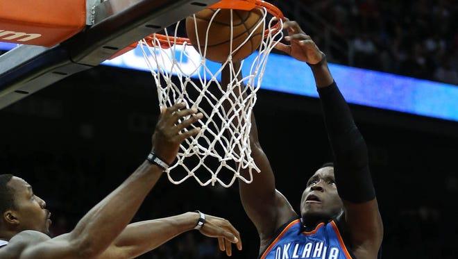 Dec 5, 2016; Atlanta, GA, USA; Oklahoma City Thunder guard Victor Oladipo (5) dunks in the second quarter against the Atlanta Hawks at Philips Arena.