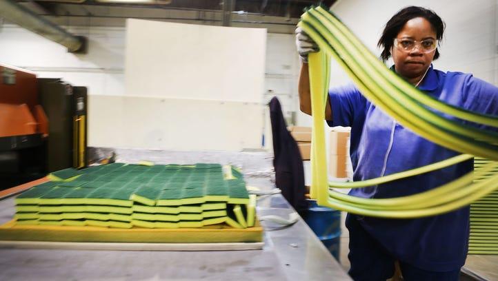Twana Thomas of Detroit is working in the fabrication