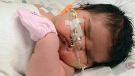 """This image provided by Children's Hospital Colorado shows Mia Yasmin Garcia shortly after birth Dec. 2. She was born by cesarean section in Alamosa, Colorado Monday, weighing 13 pounds, 13 ounces. Mia's father, Francisco Garcia, says the newborn's size shocked everyone, including hospital staff. He says """"they were like whoa! They opened their eyes like they've never seen a baby like that."""""""