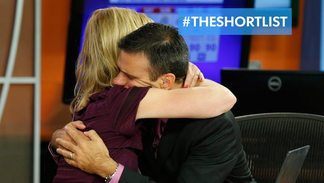 WDBJ7-TV anchors hug during a broadcast Aug. 27, 2015. Their colleagues, Alison Parker and Adam Ward, were fatally shot during an on-air interview Aug. 26, 2015, by a former colleague.