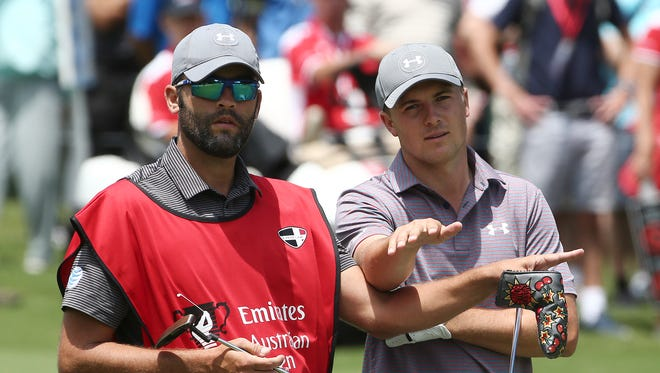 Jordan Spieth and caddie play the seventh hole Friday.