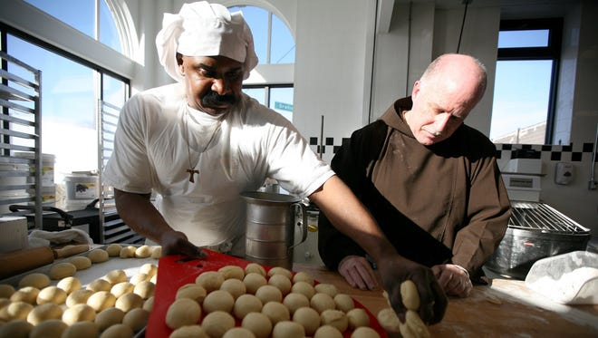 Edward Collins Jr. cqaj 62, of Detroit left and Brother Ray Stadmeyer, of Reaching, our Potential Everyday, or ROPE prepare breads from the kitchen area of On the Rise Bakery in Detroit, Wednesday, December 23, 2009.  ANDRE J. JACKSON/Detroit Free Press