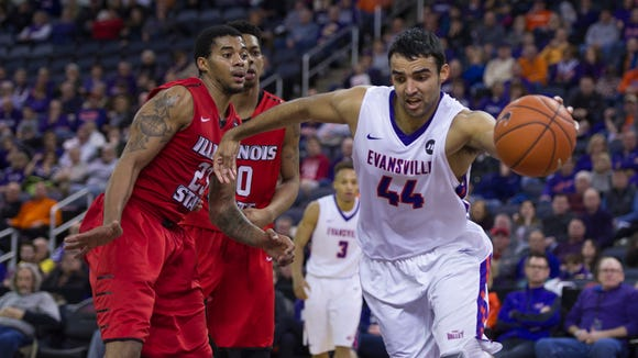 Evansville's David Howard (44) drives the baseline before being fouled by Illinois State's Deontae Hawkins (23) during their game at the Ford Center in Evansville, Ind., Sunday afternoon. The Redbirds beat the Purple Aces 61-53 to remain unbeaten in the MVC. Hawkins fouled out of the game on the play.