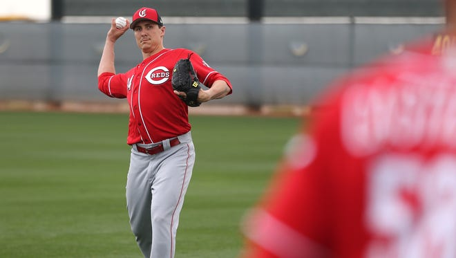 Cincinnati Reds pitcher Homer Bailey (34) long tosses with pitcher Luis Castillo (58), Wednesday, Feb. 14, 2018, at the Cincinnati Reds Spring Training facility in Goodyear, Arizona.