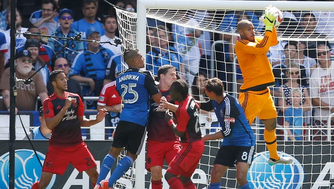 Portland Timbers goalkeeper Adam Kwarasey (12) makes a save against the San Jose Earthquakes during the second half of an MLS match Sunday, August 2, 2015, in San Jose, Calif.  The teams tied 0-0.