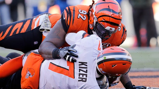 Cincinnati Bengals defensive tackle Pat Sims (92) sacks Cleveland Browns quarterback DeShone Kizer (7) in the third quarter of the NFL Week 12 game between the Cincinnati Bengals and the Cleveland Browns at Paul Brown Stadium in downtown Cincinnati on Sunday, Nov. 26, 2017. The Bengals improved to 5-6 with a 30-16 win over the Browns.