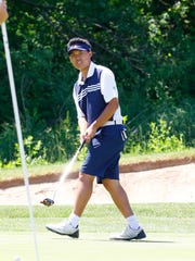 West's Josh Yang reacts after missing a putt on the No. 7  hole during WIAA Division 1 state boys golf tournament Tuesday,