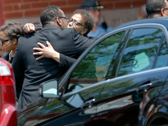 R&B singer Bobby Brown hugs an unidentified woman after a funeral service for his daughter, Bobbi Kristina Brown, Saturday, Aug. 1, 2015, in Alpharetta, Ga.