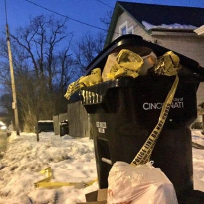 Crime scene tape in the trash at the scene of a police