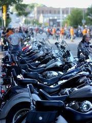 Parked bikes line Main Ave Saturday night during Hot Harley Nights.  (Elisha Page/Argus Leader)