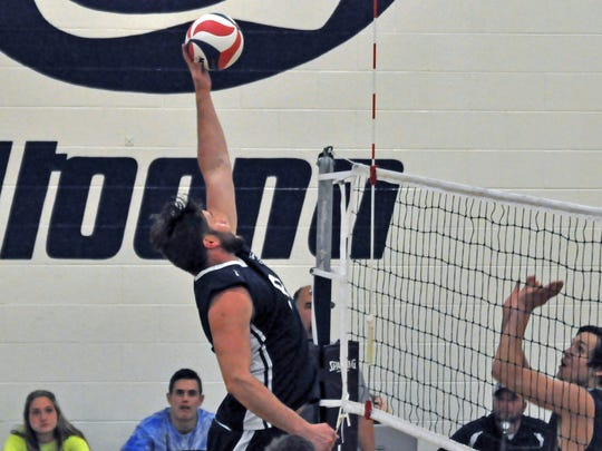 Justin Bannister goes up for a kill during a match against Wilkes University on April 10, 2017.