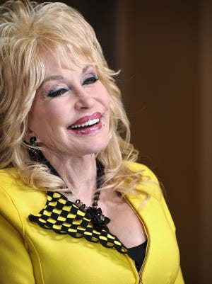 Dolly Parton will play an acoustic concert at Ryman Auditorium in July.