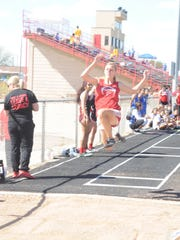 Loving's Erica Proudfoot flies into the dirt during the girls long jump Monday at Eunice.