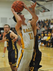 Brody Martin goes up for a layup.
