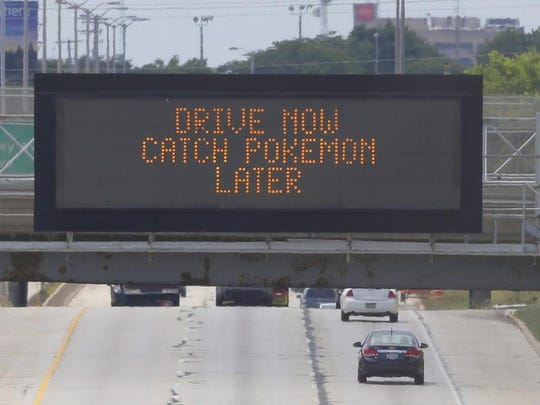 "A highway sign over 1-43 in Milwaukee reads ""Drive now catch Pokemon later"""