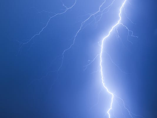 Bright lightning on a dark blue night sky