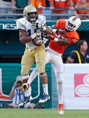 Miami cornerback Ladarius Gunter breaks up a pass during