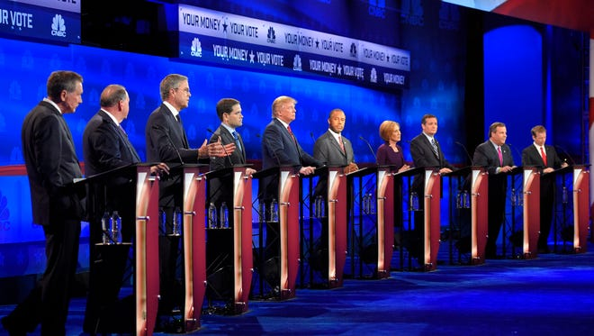 Republican presidential candidates, from left, John Kasich, Mike Huckabee, Jeb Bush, Marco Rubio, Donald Trump, Ben Carson, Carly Fiorina, Ted Cruz, Chris Christie, and Rand Paul appear during the CNBC Republican presidential debate at the University of Colorado.