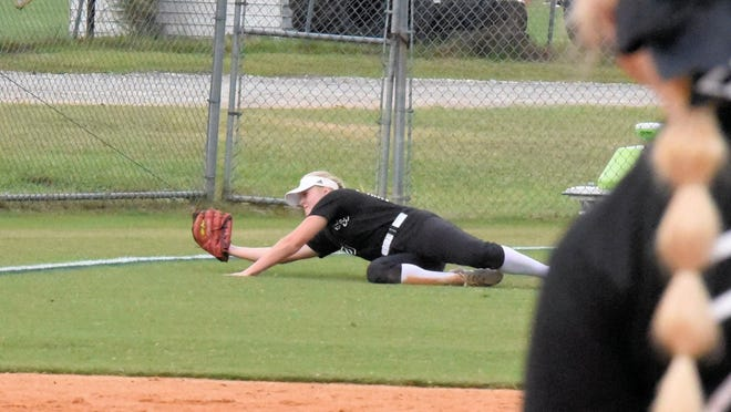 South Effingham's Avery Roddenberry (10) catches a tough pop fly down the left-field  line in the top of the sixth inning of Game 1 against Northside Warner Robbins in the second round of the GHSA Class 6A state playoffs on Oct. 22 in Guyton.